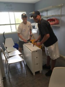 Two members of LD Class of 2016 assemble furniture for the class project, benefiting Nexus Recovery Center