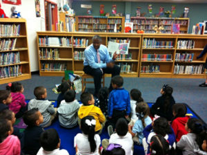 Leadership Dallas class member reads to school children during Principal For A Day.